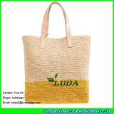 LDLF-013 natural color and light yellow striped raffia tote pom poms straw raffia bag for women travel on beach
